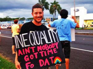 Mika Mulkey, Vice President of Pride Hilo, protests for marriage equality on Mamalahoa Highway. Photo provided by Stephanie Shor.