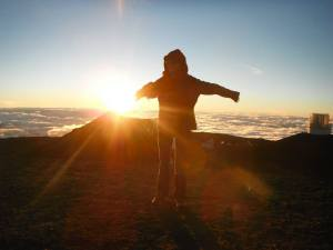 A student on an Outdoor eDventures trip pictured at the summit of Mauna Kea.